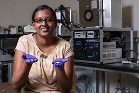 Rice University graduate student Sruthi Radhakrishnan shows samples of pure hexagonal boron nitride and fluorinated hexagonal boron nitride. Photo: Jeff Fitlow/Rice University.