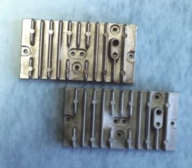 "Figure 2: Cast aluminum alloy ""383"" before (bottom) and after (top) plating with electroless nickel."