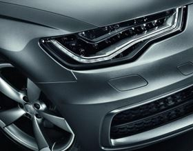 High style in the front lighting of the 2012 model Audi A6 gets support from low-profile BMW 304 glass/polyester in the headlamp frame and bulb cluster. (Picture courtesy of BMCI.)