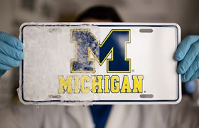 The novel icephobic coating was applied to the right half of the license plate in this photo, preventing ice from sticking to that half after being placed in a freezer. Photo: Evan Dougherty, Michigan Engineering.