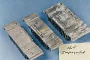 Figure 4b Figure 4a and 4b: Typical results for impregnated vs. un-impregnated anodized aluminum heat sinks. [Photos courtesy of Anoplate Corporation, Syracuse, N.Y.]