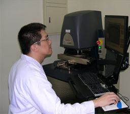 Stream Chung, PhD, regional senior application manager, adjusts the laser profiler that is housed at the Enthone Semiconductor Applications Center in Taiwan.
