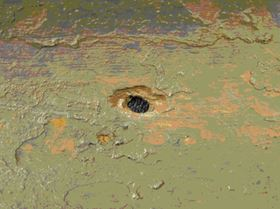 Pipe leak following removal of corrosion blisters.