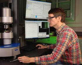 This photo shows NIST researcher Anthony Kotula using the new rheo-Raman microscope. Photo: D. Anderson/NIST.