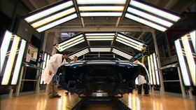 """Final check in the varnishing line. BASF says its new iGloss clearcoat allows vehicles to look """"good as new"""" for longer periods of time."""
