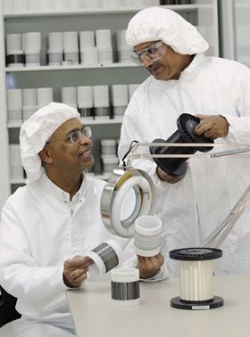 Professor Satish Kumar and research engineer M.G. Kamath examine the precursor and carbon fibers processed at Georgia Tech. (Photo courtesy Gary Meek, Georgia Tech.)