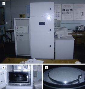 Figure 6. Selective laser sintering installation developed in the Powder Metallurgy Institute.: a – general view; b –working chamber; c –technology platform