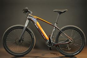 The All-Go lightweight electric bike has a frame made with carbon fiber.