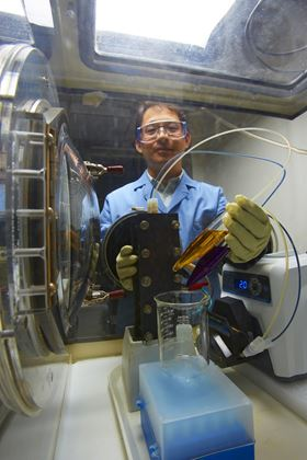 PNNL researcher Xiaoliang Wei prepares a small demonstration organic flow battery. Photo: Pacific Northwest National Laboratory.