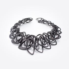 The necklace was 3D printed in steel using ExOnes binder jetting technology.