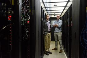 Evan Reed, assistant professor of materials science and engineering at Stanford, and graduate student Austin Sendek are using artificial intelligence to develop safer batteries. Photo: L.A. Cicero/Stanford News Service.