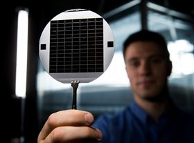 This shows a disc of microchips with flexible glass membranes. Photo: Jaren Wilkey/BYU Photo.
