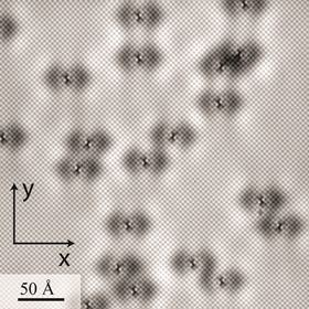 This image produced by a spectroscopic imaging scanning tunneling microscope reveals the location of every atom on the surface of iron selenide, as well as every single atomic defect in the field of view. The white dots making up squares arrayed 45° to the x/y-axis are selenium (Se) atoms, while the defects  missing Fe atoms in the Fe plane, about a quarter of a nanometer below the Se surface  show up as butterfly-shaped perturbations produced by quantum interference of electrons scattering from the defects. These scattering interference patterns led to the discovery of orbital selective Cooper pairing in iron selenide. Image: Brookhaven Lab/Cornell U.