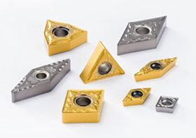 TN620 (silver) and PV720 (gold) metal-cutting inserts.