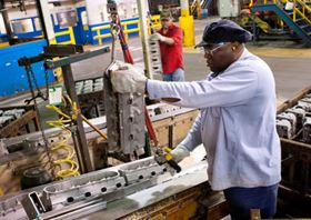 Quentin Wright, a General Motors Saginaw Metal Casting employee, working in the Saginaw, Mich., plant, which will receive a $215 million infusion for production of future engine block and head casting work. (Photo by John F. Martin for General Motors.)