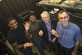 Rice University researchers (from left) Olawale Lawal, Ramathasan Thevamaran, Edwin Thomas and Sadegh Yazdi hold clay models of deformed cubes that represent the results of their microscale experiments. The researchers smashed silver microcubes at near supersonic speeds to see how deforming their crystalline structures could make them stronger and tougher. Photo: Jeff Fitlow/Rice University.