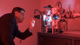 Yogesh Vohra at the Microfab Labs sputter machine, which coats the gem diamond in a layer of tungsten. Photo: UAB.