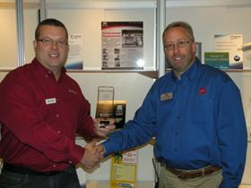 Mike Wittenhagen (right), technical manager at the Powder Coating Institute, presents the 2012 Product Showcase Award to DeFelsko's Terry LaRue (left), during the close of the COATING 2012 show in St. Louis, Mo.