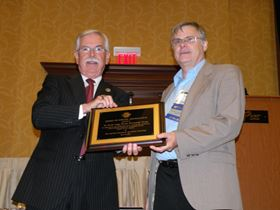 Dr. Keith Legg (right), Rowan Technology Corp., earns the the Award of Special Recognition.