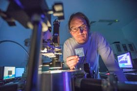 Jonathan Coleman from AMBER at Trinity College Dublin holds a transistor printed with layered materials; coupling graphene with other layered materials can lead to intelligent smart devices. Photo: AMBER, Trinity College Dublin.