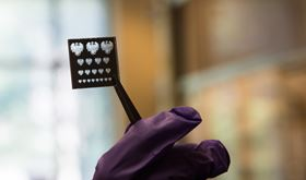 This shows a 'mask' or stencil for patterning nanomaterials using a new process that promises to make them far easier to incorporate into LEDs, solar cells, transistors and other electronics. Photo: University of Chicago.