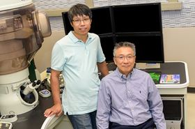 Qingxiao Wang (left) and Moon Kim (right) used the atomic resolution electron microscope at UT Dallas to characterize the tiny transistor, just 1nm in size. Photo: UT Dallas.