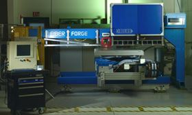 Fiberforge's Relay™ manufacturing system uses prepreg tape in an automated lay-up process to produce tailored blanks, which are thermoformed into finished parts.