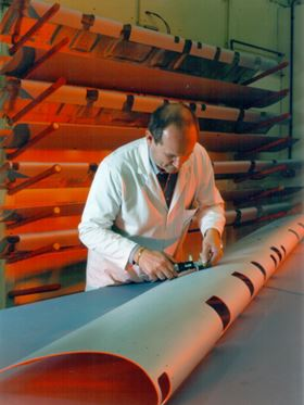 A Hamble technician working on a composite part of a wing leading edge.