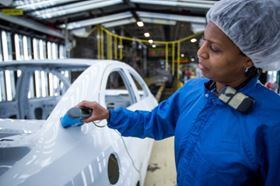 "A paint shop team member measures the ""appearance"" of a vehicle at the General Motors Lake Orion Plant in Orion Township, Michigan. (Photo by Jeffrey Sauger for General Motors.)"
