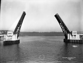 A bascule bridge example is the Lewis and Clark River bridge in Oregon. It is a single-leaf bascule-type drawbridge built in 1924. It was rehabilitated in 2002 with a new FRP deck, operating machinery, machinery house restoration, bridge rail retrofit, and repairs to the approach (see below).