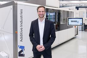 Simon Hoeges, GKN AM director, in front of the MetalFAB1. Photo courtesy GKN Sinter Metals/Photographer/Ralf Bille.