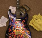 A guitar is just one of many potential applications for free-form coloring and use of silk-screening techniques.