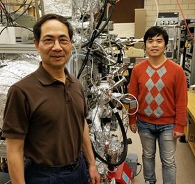 Tai-Chang Chiang and graduate student Caizhi Xu pose in Chang's laboratory at the Frederick Seitz Materials Research Lab at the University of Illinois at Urbana-Champaign. Photo: Physics Illinois.