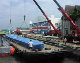 Completed moulds being embarked onto a barge at Cowes, Venture Quays, for onward transportation.