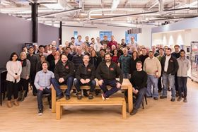 Ric Fulop (seated front right), and other members of the Desktop Metal team. (Photo courtesy Business Wire).