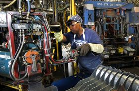 GM employee Laverne Johnson works in the body shop at the Arlington complex. Photo courtesy of Mike Stone for Chevrolet.