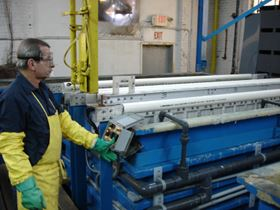Experienced operators monitor each phase of the finishing process, including the triple-rinse stage.