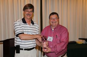 Sam Woehler (right), CCAI National president, congratulates Jim Docken, DuBois Chemicals, who was honored with the 2013 CCAI James F. Wright Lifetime Achievement Award.
