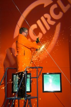 Pierre Somers, Chairman and CEO, Walter  Surface Technologies International, cutting chain to access the new Bio-Circle facility.