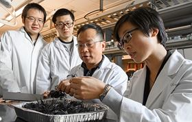 Jinwen Zhang with his carbon fiber recycling research team.