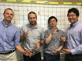 Left to right: Bradley Olsen, Jeremiah Johnson, Rui Wang and Ken Kawamoto from MIT demonstrate polymer elasticity using rubber bands. Photo: Hursh Vardhan Sureka.
