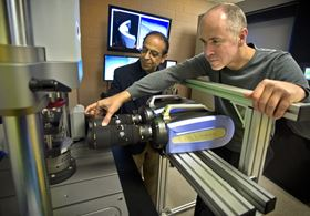 Andrew Makeev, right, professor in the mechanical and aerospace engineering department and director of the UT Arlington Advanced Materials and Structures Lab, looks over research results with Erian Armanios, chair of the mechanical and aerospace engineering department.