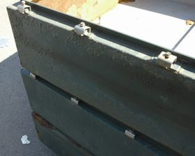 Figure 1: Blisters on the external surface of a hinged steel box.