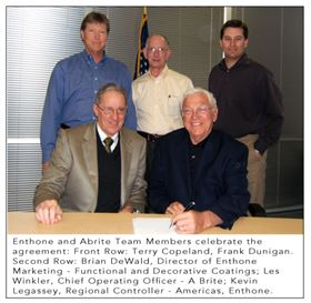 Enthone and A-Brite Team Members celebrate the agreement. Front row: Terry Copeland, Frank Dunigan. Second row: Brian DeWald, Director of Enthone Marketing-Functional and Decorative Coatings; Les Winkler, COO, A Brite; and Kevin Legassey, Regional Controller-Americas, Enthone.