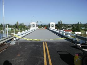 FRP deck and polymer concrete wear surface installed on Lewis and Clark River Bridge.
