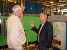 U.S. Senator Lindsey Graham (R-SC) gets a tutorial about the surface finishing industry from a plater's perspective by John Cutchin, left, president of Palmetto Plating.