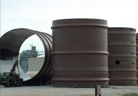 Sizeable FGD solution: there's nothing small about the corrosion-resistance benefits of glass/vinyl ester in these 20 m, 10 m diameter stack liners fabricated with Reichhold resins by Augusta Fiberglass in Blackville, South Carolina, USA. The liners are stacked up to 300 m in coal-fired power plants. (Picture courtesy of Reichhold.)
