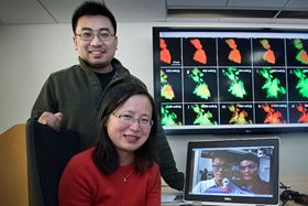 Jun Wang (sitting), Christopher Eng (standing), Jiajun Wang (left, laptop screen) and Liguang Wang (right, laptop screen) at Brookhaven National Laboratory used transmission x-ray microscopy combined with spectroscopy to produce the colored maps shown on the large screen. These maps reveal the structural expansion (and the resulting cracks/fractures) and chemical composition changes that occur as sodium ions (Fe, green) are added to and removed from iron sulfide (FeS, red) during the battery's first discharge/charge cycle. The pristine iron sulfide (box in upper left) does not return to its original state after this cycle, as some sodium ions remain trapped in the core (box in lower right). This causes an initial loss in battery capacity. Images: Brookhaven National Laboratory.