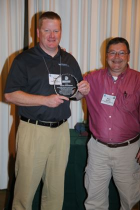 Todd Luciano, left, proudly accepts CCAI Appreciation Award from Sam Woehler, CCAI National president.