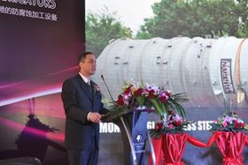 Steven Muscarella addressing the audience of Chemical, Pharmaceutical, and Process Industry Professionals during the Grand Opening ceremony of TITAN Metal Fabricators (Wuxi) Co., Ltd.  One TITAN's custom designed reactive metal fabrications is pictured in the background.